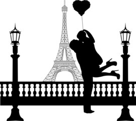 Couple in love with heart in front of Eiffel tower in Paris