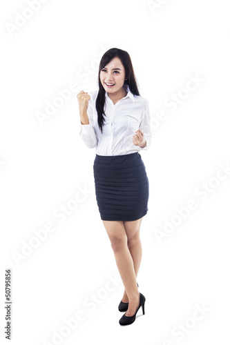 Businesswoman winning isolated on white