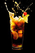 Splashing Cuba Libre Cocktail on black