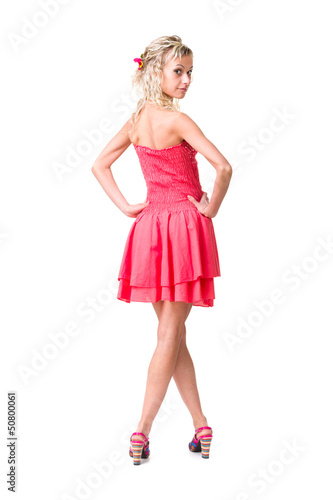 attractive young woman full length studio portrait