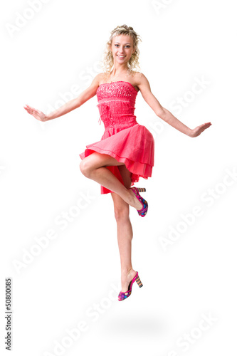 Cute elegant woman in little dress jumping