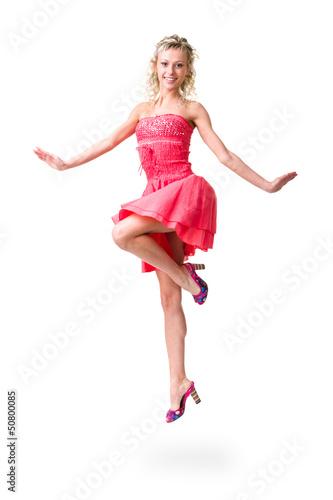 Cute elegant woman in little dress jumping