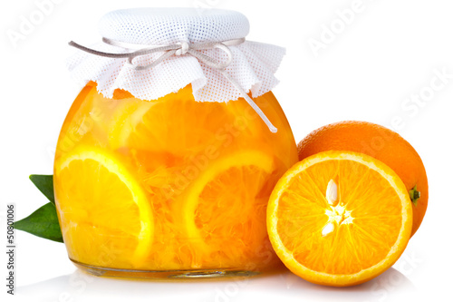 Orange jam with ripe fruits isolated