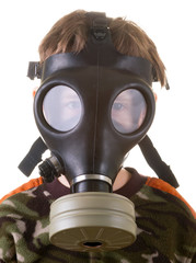 Boy in a gas mask isolated on white background