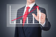 Businessman pointing a graph with the progress of the business