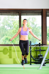 Woman jumping with rope, jumping rope
