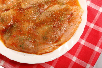 Raw marinated chicken breasts with spices