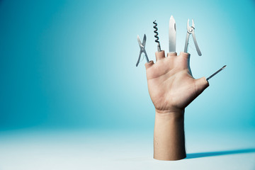 Hand with tools as fingers