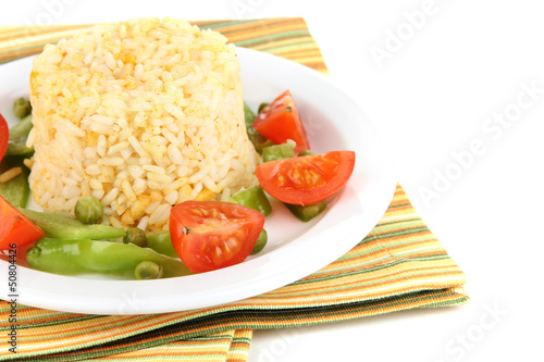Delicious risotto with vegetables isolated on white