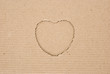 cardboard corrugated with a heart shape cut out, angled