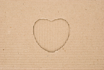 cardboard corrugated with a heart shape cut out, vertical