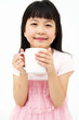 Beautiful little asian girl with mug