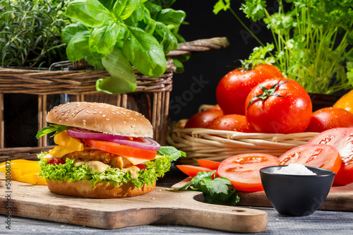 Hamburger with chicken, vegetables fresh herbs