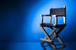 Director chair on a dramatic lit background