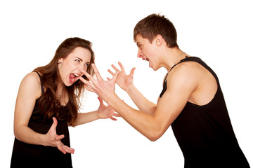 Teenagers boy and girl quarreling, gesticulating and shouting