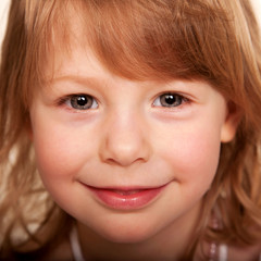 Beautiful funny red-haired little girl.