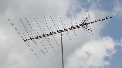 TV antenna with clouds moving.