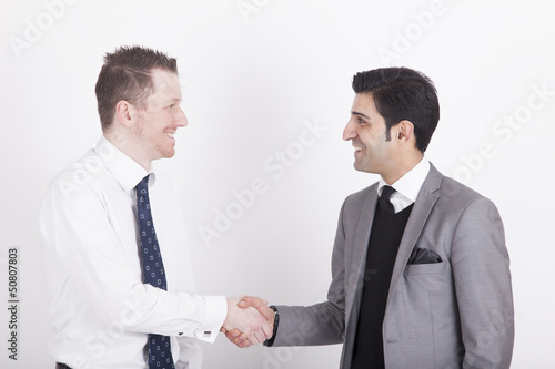 handshaking business partners