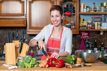 beautiful housewife cooking vegetables