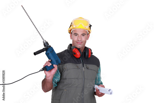 Man holding drill and plans