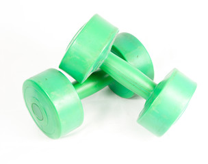 green dumbbell isolated on a white background