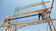 Roofing works - builders on the scaffolding