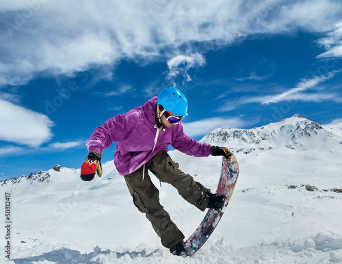 Snowboarder in mountains