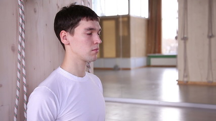 young man meditates in the gym 2