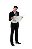 Businessman stood reading the newspaper
