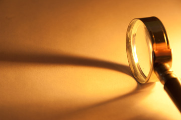 Close Up of magnifying glass with beam of light.