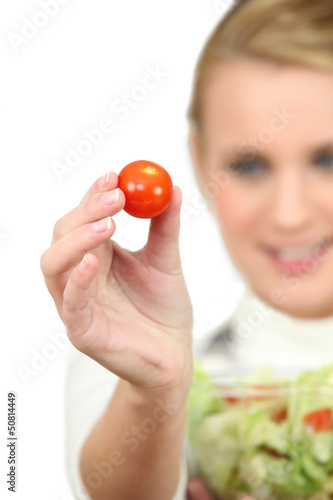 Woman holding a salad bowl