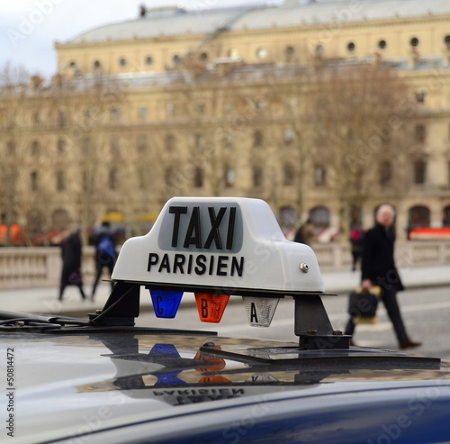 Paris Taxi On A Bridge With People In The Background