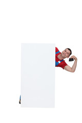 Plumber posing by poster holding purse