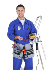 Handyman holding a multimeter