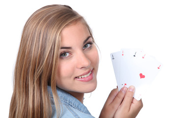 Young woman holding four aces
