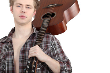 Man carrying acoustic guitar