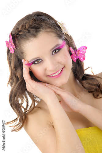 Beautiful girl with butterflies in her hair and make-up