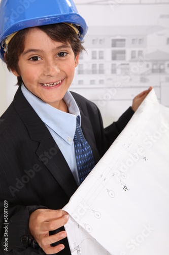 Little boy imitating architect