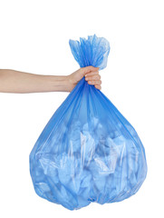 Close up of garbage bag holding by hand