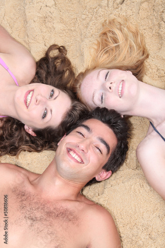 Teens relaxing at the beach