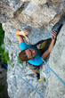 Woman Practices In Climbing At...