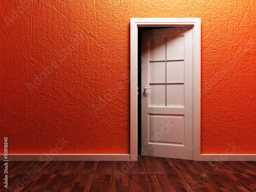 White opened door in the empty room