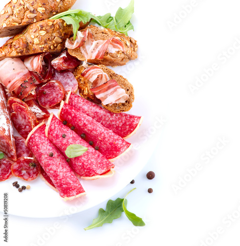 Sausage. Italian Ham, Salami and Bacon isolated on White