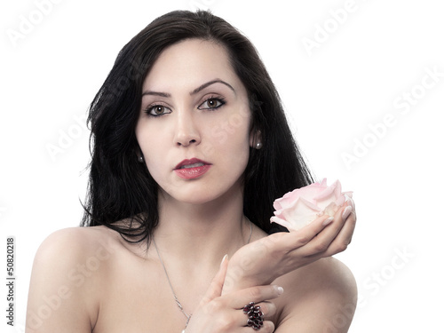 pretty young woman with a rose in his left hand - isolated