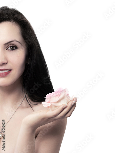 young woman with a rose in his left hand - isolated