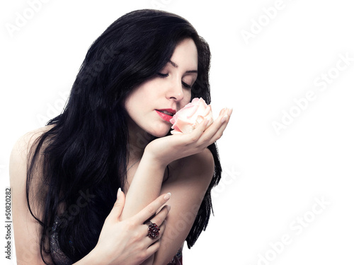 pretty young woman smelling a rose - isolated