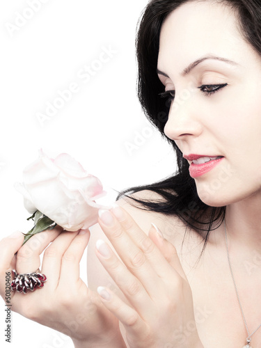 sweet young woman with a fragrant rose - isolated