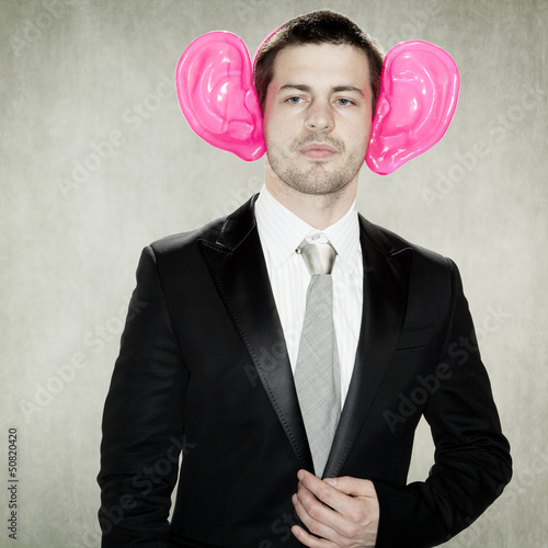 handsome businessman with enormous ears