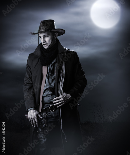 Handsome man in cowboy costume