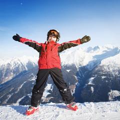 Child having fun in mountains